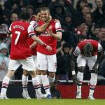 Arsenal keeps hopes alive, beats Wigan