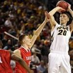 White leads Hawkeyes to 83-52 win over Davidson