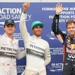 Hamilton beats Vettel to rain-hit Malaysian pole