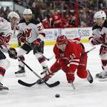 Rask has 2 goals as Canes beat Devils 3-2