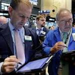 US stock indexes rise in late trading; Apple jumps