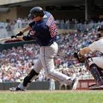 Brantley lifts Indians over Twins in extras