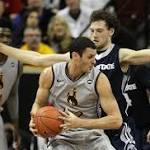 Wyoming uses second-half push to escape Utah State