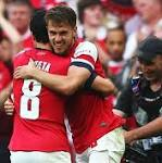 Wenger ready to sign new Arsenal deal, hails players after FA Cup title win