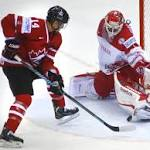 Latvia upsets US, Canada routs Denmark at Worlds