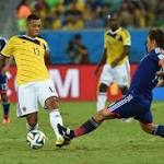 Colombia crush Japan to win group, face Uruguay