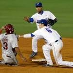 Ninth-inning homers knock Gators into loser's bracket