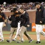Giants' Lincecum escapes major injury on grounder
