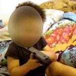 Indiana couple arrested for taping baby playing with handgun