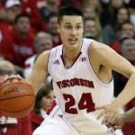 Badgers' Title Hopes May Rest in Hands of Hero Born of Necessity and Talent