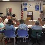 Waiting for details on Clinton & Obama event, volunteers make calls