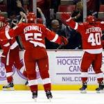 Red Wings score 3 late goals to stun Penguins