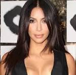 Kim Kardashian sports a corset at the gym