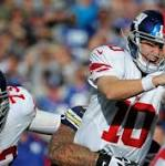 NFL-Seahawks shut out Giants, Dolphins deny Patriots