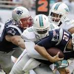 Miami Dolphins' offensive line keeps quarterback Ryan Tannehill upright in ...