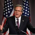 Jeb Bush vows his own course while tapping longtime family advisers