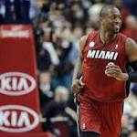 Wade re-signs with Heat; Boozer out