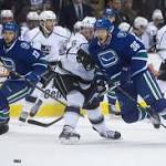 Kings score two late goals to down Canucks, 3-2
