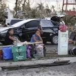 Desperate survivors seek to flee Typhoon Haiyan zone