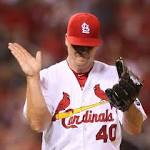 Power puts Cardinals ahead as Cubs mount a threat