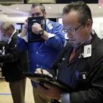 US companies waver ahead of Fed meeting; tech stocks plunge