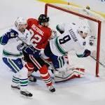 Daniel Sedin leads Canucks past Blackhawks 5-4