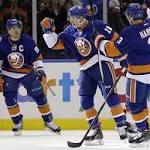 Halak tops Flames to set Islanders' single-season win record