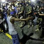 Chinese and Russian state media use Ferguson unrest to paint US as land of ...