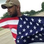 'Our Community Is Not Scared': Man Holds American Flag Outside Site of ...