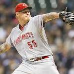 WISCONSIN SPORTS ROUND-UP: Reds edge Brewers despite rally