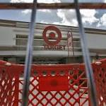 Target cuts outlook as breach fallout lingers