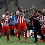 Olympiacos shock Atletico Madrid on opening day in Athens