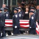 Large contingent of area police pay respects at Rochester officer's funeral