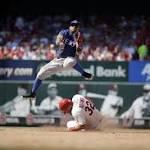Rangers rally to beat Cardinals