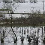 Flooded British villages ignite climate debate