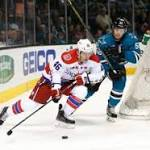 Caps get assist from officials in win over Sharks