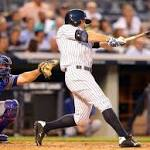Yankees top Rangers 2-1 in rain-shortened game