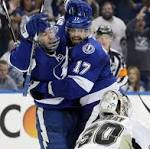 Lightning hold off Penguins' late rally to even series 2-2