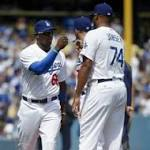 Dodgers outfielder Yasiel Puig injures left thumb sliding head-first