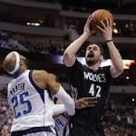 Love lifts Timberwolves over Mavericks in OT