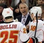 Hiller helps Flames beat Blackhawks 2-1