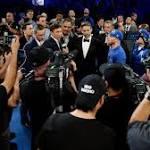Canelo Alvarez routs Julio Cesar Chavez Jr.; Golovkin fight official