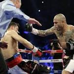 Cotto shocks Martinez to win middleweight championship