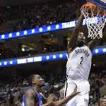 Garnett solid in return as Nets down 76ers