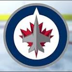 Andrew Ladd scores in overtime on fluke shot, Jets beats Wild 4-3
