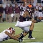 Va. Tech running back charged with assault, malicious wounding