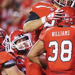 Wilson throws for 302 yards, 2 touchdowns as Utah defeats Utah State 30-26