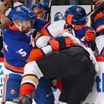 Islanders add some OT drama before break-through first win