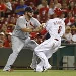 Reds' bats nearly frozen in shutout loss to Cardinals