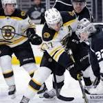 Kings have a fine day before beating Boston Bruins, 2-0